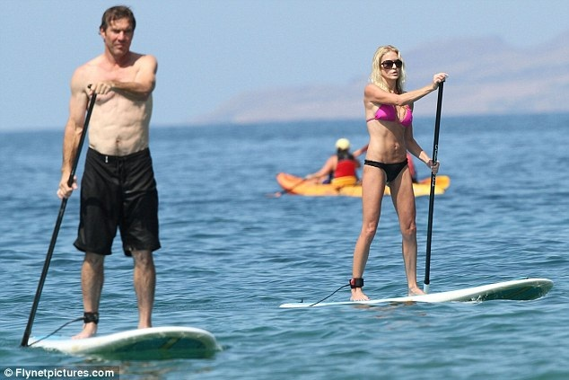 Dennis Quaid, 57, displays his six-pack while wife Kimberly shows off her toned figure as pair surf in Hawaii #SUP
