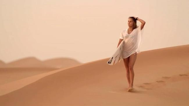 Surfer Sally Fitzgibbons tackles 3.5m waves in Arabian desert # SurfReport – Wave pool air reverse…