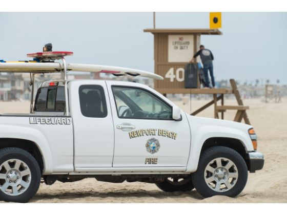 Lifeguards patrol a blackball area between 40 and 44th streets for hard boards ANGELA PIAZZA, ORANGE COUNTY REGISTER
