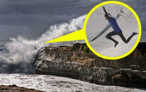 Santa Cruz Surfer Jumping off Rocks