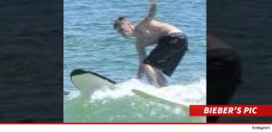Justin bieber surfing