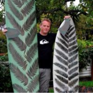 Surfing enthusiast Jeremy Buis with one of his fern leaf surfboards. Photo by Craig Baxter